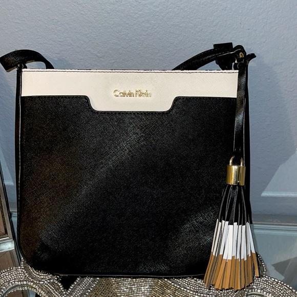 1 time use Calvin Klein cross body bag